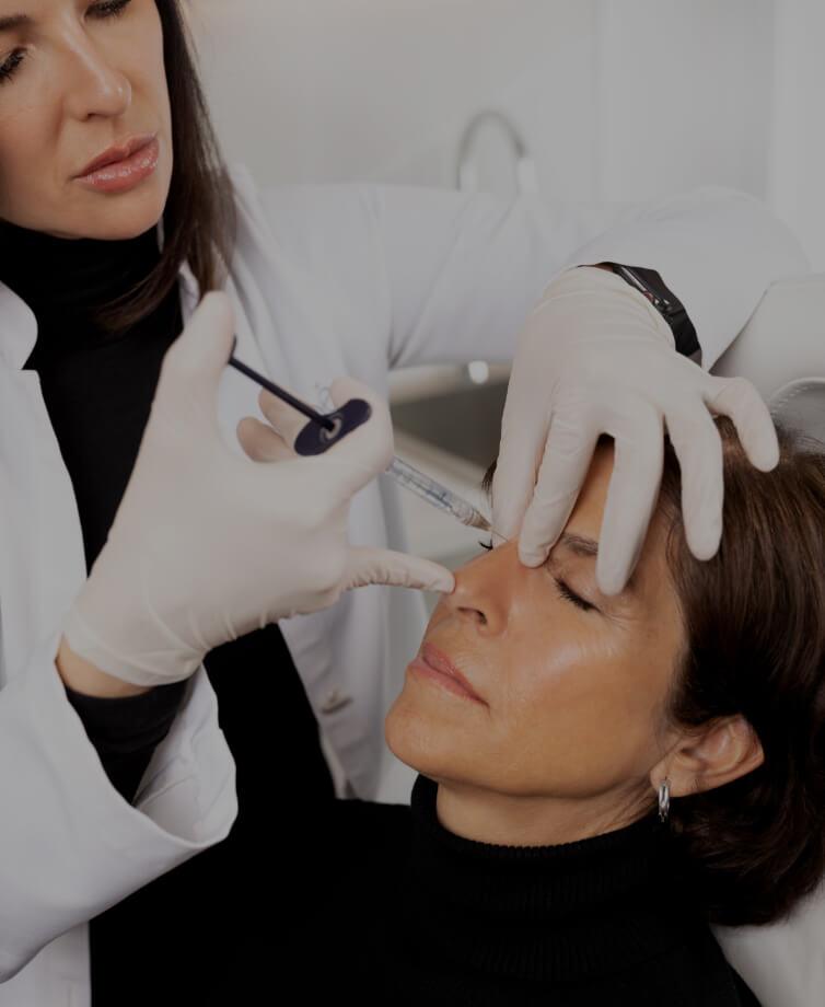 Dr. Chloé Sylvestre doing dermal filler injections for nose correction on a female patient