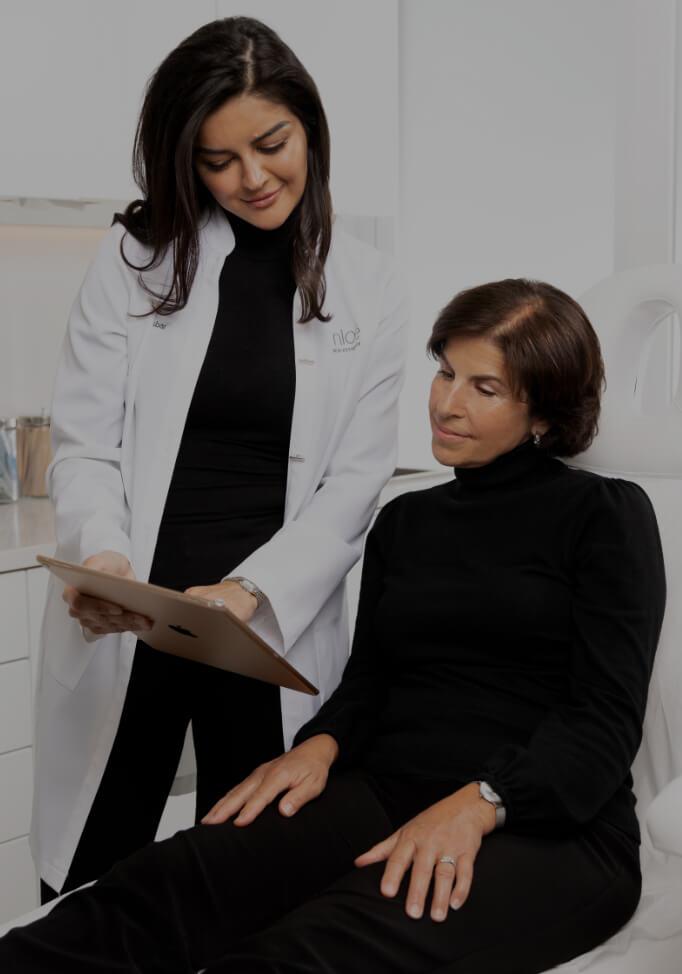 Dr. Yara Asbar preparing a syringe of neuromodulators before seeing her next patient