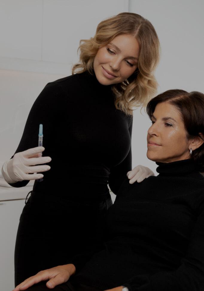 Nurse injector Amélie Castonguay listening to her patient's expectations before a dermal filler treatment