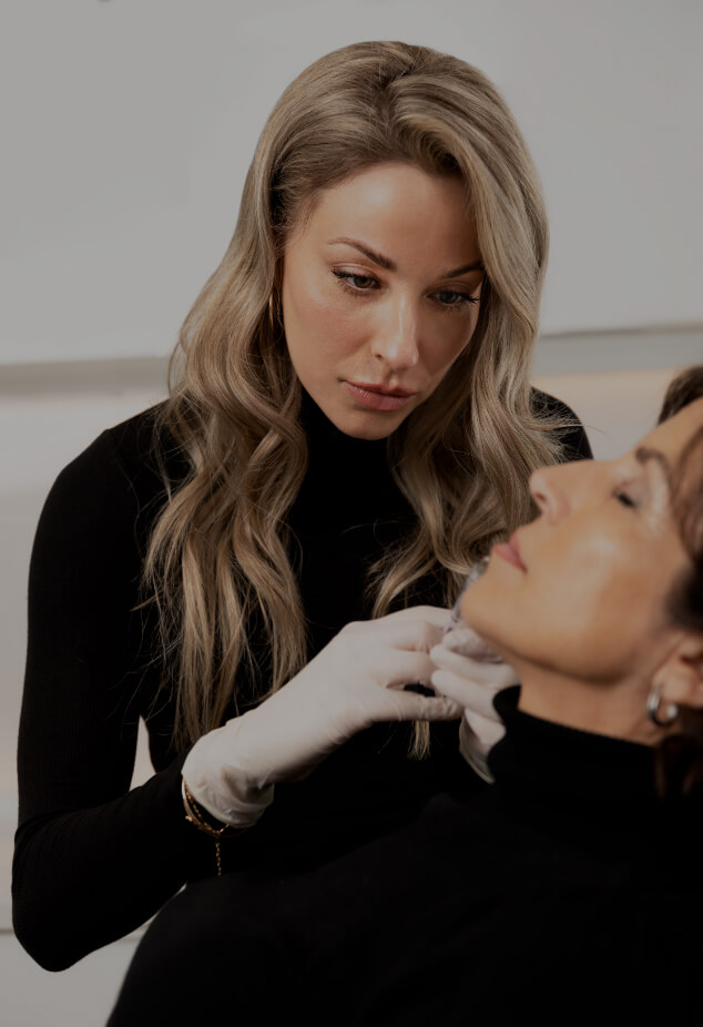 Nurse injector Anabel St-Onge performing a lip augmentation treatment with dermal fillers on a female patient