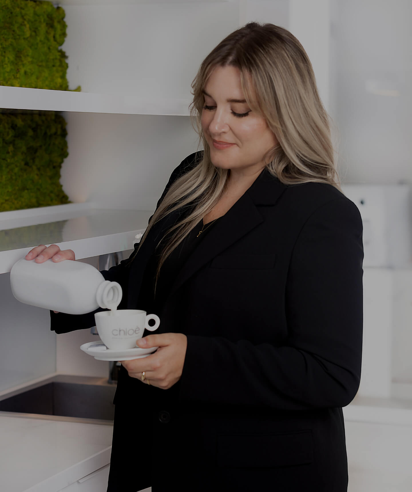 Medical receptionist Karine Leduc preparing a coffee for a patient in the waiting room of Clinique Chloé