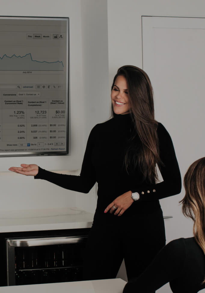 Marketing director Marie-Josée Faucher seated at a desk analyzing web performance data on a screen