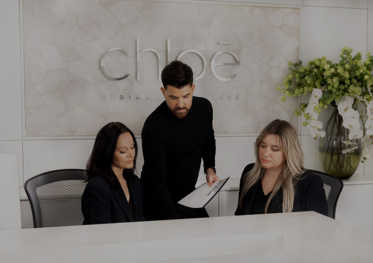 Maxime Surprenant, director of Clinique Chloé, using a smart tablet screen in the waiting room
