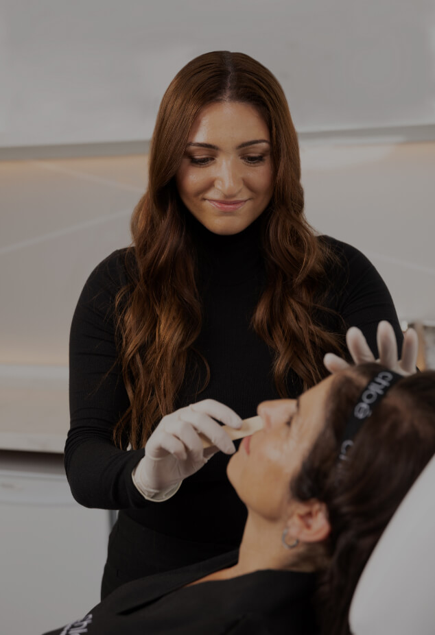 Medico-aesthetic technician Sonia D'Antico applying gel to her patient's face before an IPL treatment