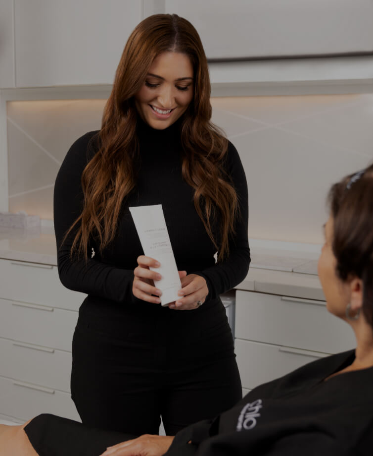 Medico-aesthetic technician Sonia D'Antico advising her patient on the right skin products to use