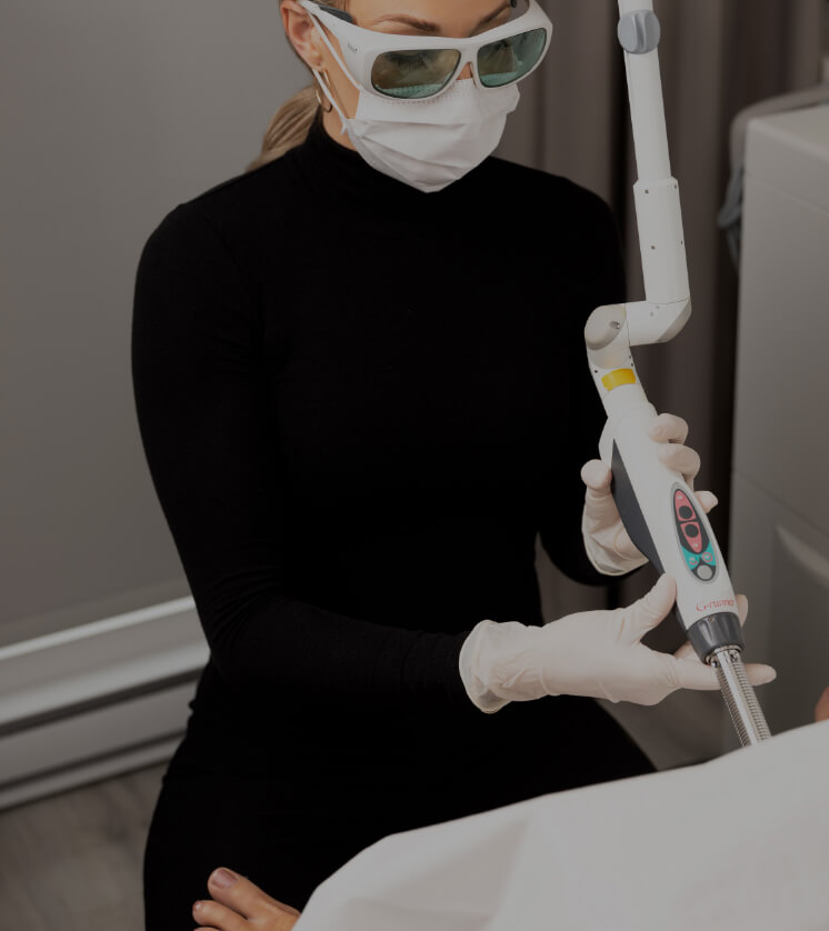 A nurse from Clinique Chloé inserting the disposable tip of the IntimaLase laser into her patient's vagina