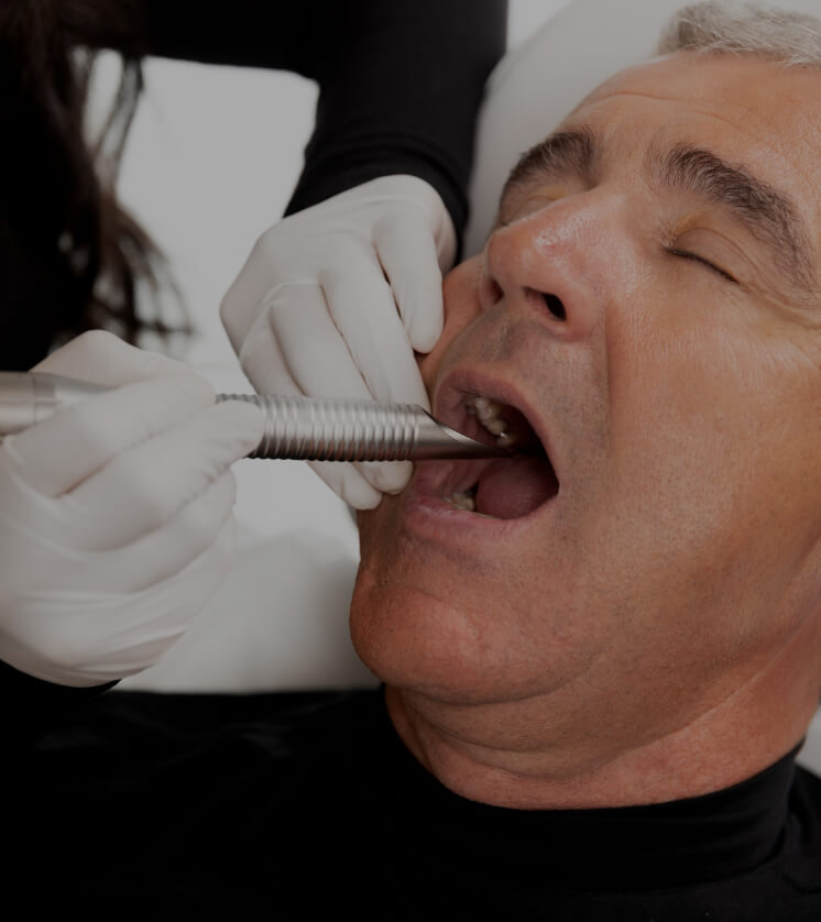 A Clinique Chloé medical aesthetic technician performing a NightLase intraoral laser treatment in a patient's mouth