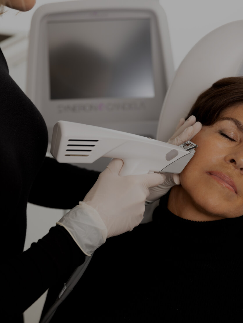 A nurse at Clinique Chloé treating a patient's face with the Profound radiofrequency microneedling device